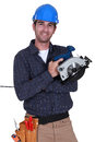 Handyman holding a circular saw Stock Photo