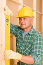 Handyman mature professional with spirit level Royalty Free Stock Photo