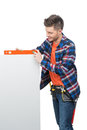 Handyman measuring level young confident craftsperson the with special tool Stock Photos
