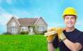 Handyman near new house. Royalty Free Stock Photo