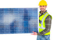 Handyman in protective clothing carrying solar panel Royalty Free Stock Photo