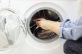 Handyman repairing a washing machine Stock Image