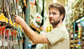 Handyman shopping in diy outlet forty years old caucasian man smiling during Royalty Free Stock Photography