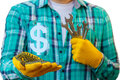 Handyman showing symbol dollar . Royalty Free Stock Photo