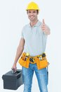 Handyman showing thumbs up while holding tool box portrait of over white background Royalty Free Stock Photography