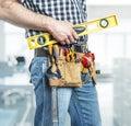 Handyman with spirit level Royalty Free Stock Photo