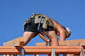 Handyman with a tool belt cable bay apr works on roof of new home in workers died of injuries caused by falls from ladders Stock Photography