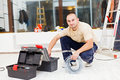 Handyman with tool box searching in his for the necessary tools Stock Images