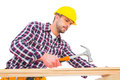 Handyman using hammer on wood Royalty Free Stock Photo