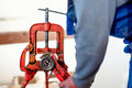 Handyman using wrench at industrial plumbing, construction site Royalty Free Stock Photo