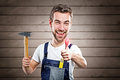 Handyman with a very red thumb Royalty Free Stock Images