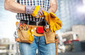 Handyman wearing gloves Royalty Free Stock Photo
