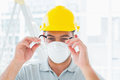 Handyman wearing protective eyewear at site confident construction Stock Photos