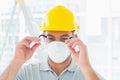 Handyman wearing protective eyewear at site Royalty Free Stock Photo