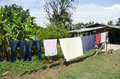 Hang clothes on the clothesline after washing for dry clothes in Royalty Free Stock Photo