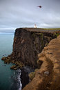 Hang-glider, black cliffs of Dyrholaey Royalty Free Stock Photography