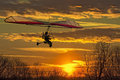 Hang glider fly in the sunset Royalty Free Stock Photo