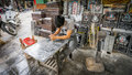 Hang mam tombstone street in hanoi s old quarter vietnam a man engraves designs a at a shop along southeast asian Royalty Free Stock Photo