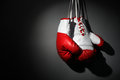 Hang up your boxing gloves hanging on wall low key gray background with copy space Stock Photos