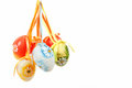 Hanged bright color easter eggs bows white background Stock Images