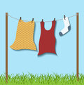 Hanged clothes on rope paper with shadow nature with grass in bottom Royalty Free Stock Image