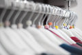 Hangers with sizes in a modern store in detail Stock Photo