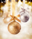 Hanging bauble with falling snow Royalty Free Stock Photo