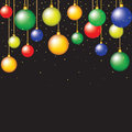 Hanging baubles on black background Royalty Free Stock Photos
