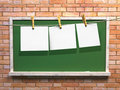 Hanging blank paper on clothesline and blackboard Stock Photos