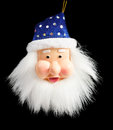 Hanging blue plastic Santa Claus  on black Stock Images