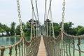 Hanging bridge crossing at the tropical palawan beach sentosa island in singapore Stock Image