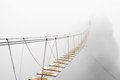 Hanging bridge in fog Royalty Free Stock Photo