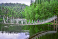 Hanging bridge over river Royalty Free Stock Photo