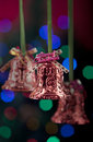 Hanging Christmas Bells with colorful lights Royalty Free Stock Photo