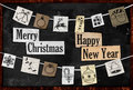 Hanging christmas greeting paper ornament on blackboard Stock Photos