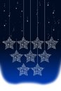Hanging Christmas star with snow Stock Photo