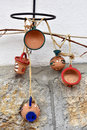 Hanging clay jugs and cups on the wall Royalty Free Stock Photo