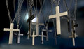 Hanging crucifixes far a group of metal from chains on a dark background Royalty Free Stock Image