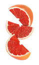 Hanging, falling and flying piece of grapefruit fruits isolated Royalty Free Stock Photo