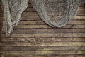 Hanging Fishnet on Rustic Wood Wall Royalty Free Stock Photo