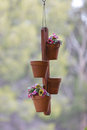 Hanging flower pots a set of four from a hook Royalty Free Stock Photos
