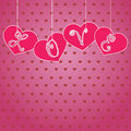 Hanging hearts with letters Stock Images