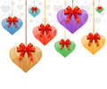 Hanging hearts with red ribbons Royalty Free Stock Image