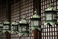 Hanging lanterns metal in front of a traditional paper wooden wall at kasuga grand shrine nara japan Stock Photo