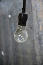 Hanging light bulbs bulbson blurred grey background Stock Image