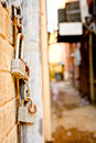 Hanging Locks and Chains Near Alley Between Buildings Royalty Free Stock Photo