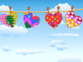 Hanging loving hearts in blue sky the background of for valentine s day Stock Images