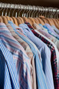 Hanging men's shirts Stock Images