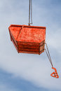 Hanging orange rubble container on build site Stock Photos