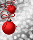 Hanging Ornaments on Blurred Silver Background Royalty Free Stock Photography